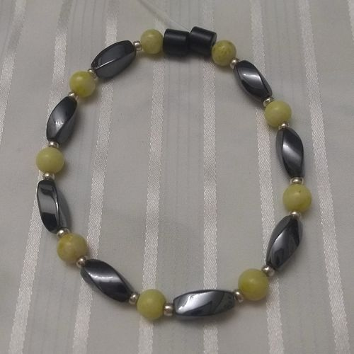 Woman Single 35.00: Jade Phoenix + Twist Magnetic Hematite